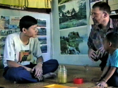 Asoka discussing herbal medicine with Pichet